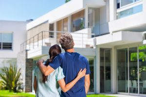 BUYERS-SERVICES-couple-looking-back-at-contemporary-house